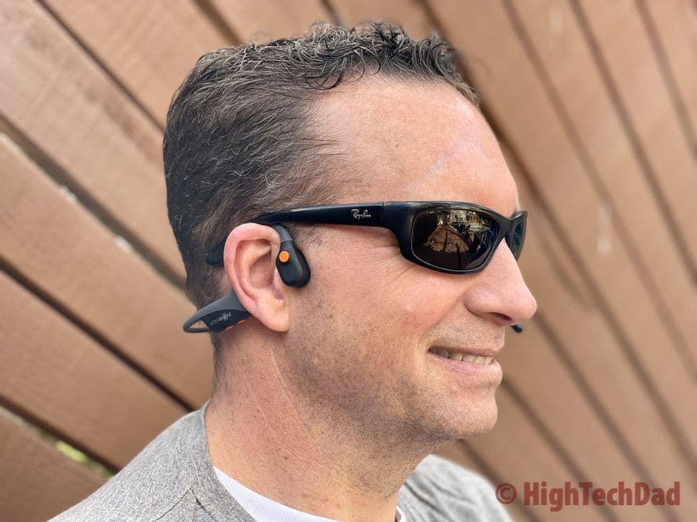 Open ear design of the AfterShokz OpenComm headset - using bone conduction technology - HighTechDad review